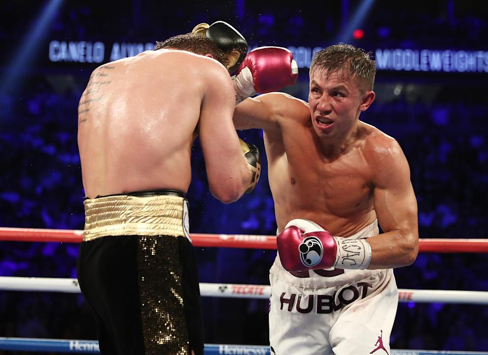Gennady Golovkin (R), firing a right last September at Canelo Alvarez, signed with online streaming service DAZN on Friday, setting up a potential third bout with his Mexican rival later in the year. (Getty Images)