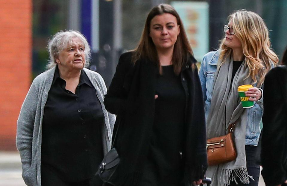 Christina Pomfrey (left), 65, and Aimee Brown (centre left), 34, arrive at Minshull Street Crown Court in Manchester to face sentencing for charges of benefit fraud.