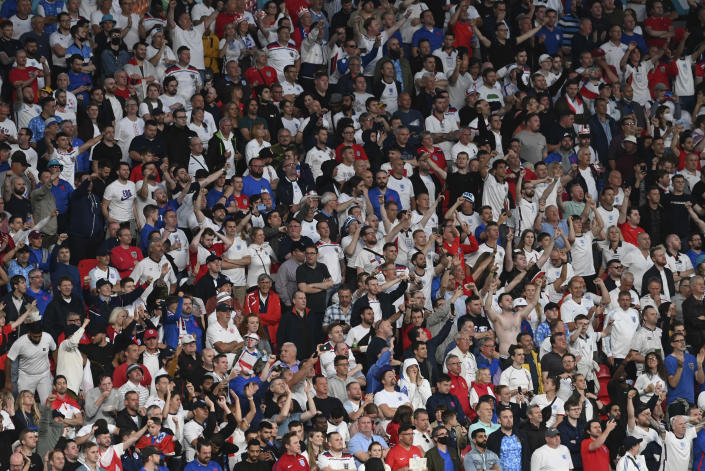 England fans cheer during the Euro 2020 final soccer match between Italy and England at Wembley stadium in London, Sunday, July 11, 2021. (Facundo Arrizabalaga/Pool via AP)