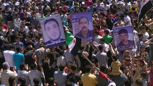 Picture from the Syrian opposition's Shaam News Network April 13, shows a demonstration against Syrian President Bashar al-Assad in the town of Daraa. AFP is using pictures from alternative sources as it was not authorised to cover this event and is not responsible for alterations that cannot be independently verified