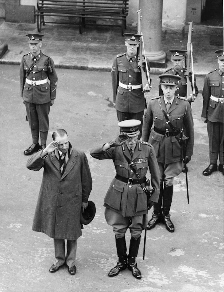 Australian cricketer Don Bradman (1908 - 2001) takes the salute alongside General Charles Borington during a brief visit to Gibraltar. (Photo by Keystone/Getty Images)