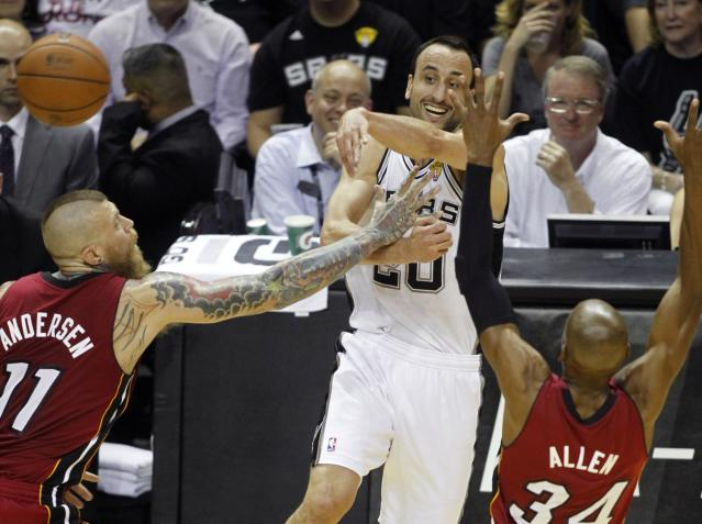 San Antonio Spurs' Manu Ginobili (C) of Argentina passes over Miami Heat's Chris Andersen (L) and Ray Allen during the first quarter in Game 1 of their NBA Finals basketball series in San Antonio, Texas June 5, 2014. REUTERS/Mike Stone (UNITED STATES - Tags: SPORT BASKETBALL)