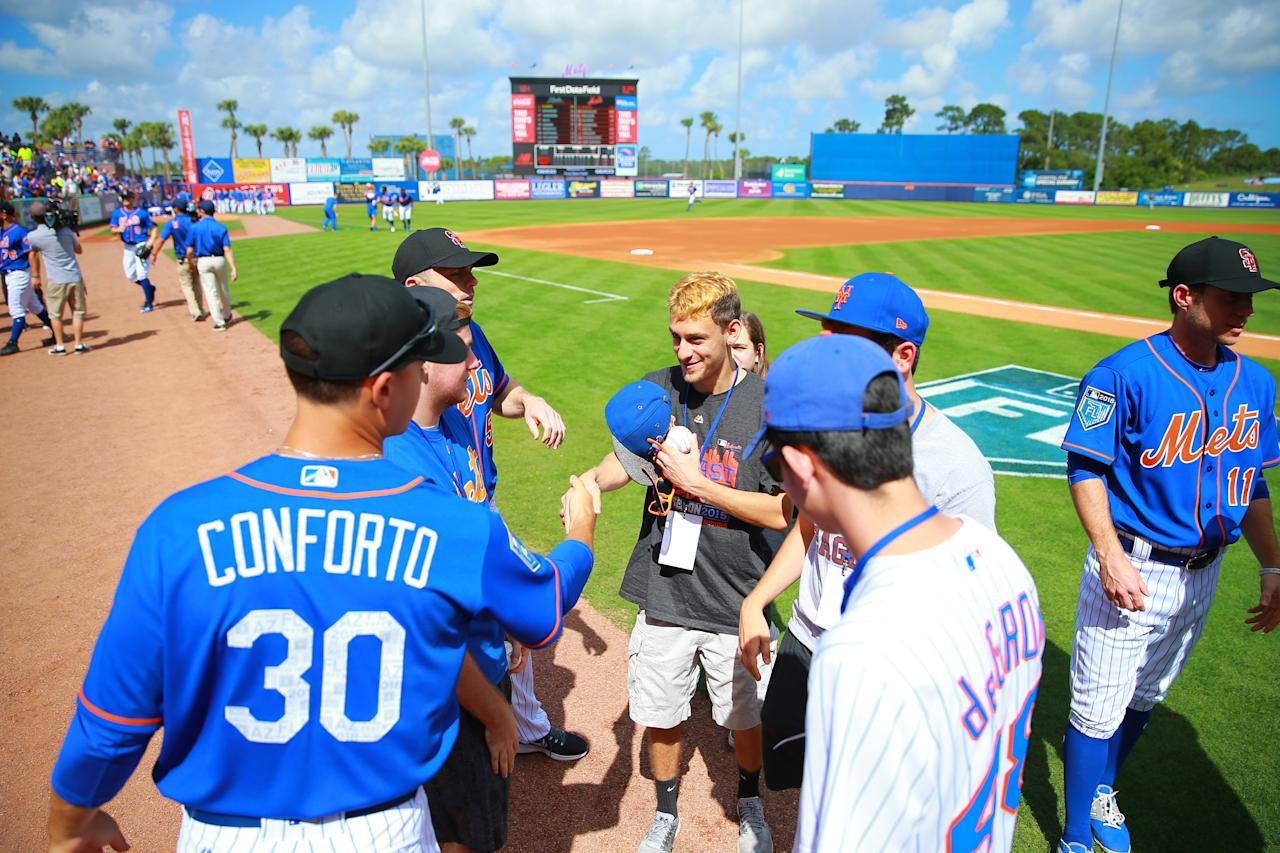 <p>Students from Marjory Stoneman Douglas High School in Parkland, Fl. meet New York Mets players before the baseball game against the Atlanta Braves at First Data Field in Port St. Lucie, Fl., Feb. 23, 2018. (Photo: Gordon Donovan/Yahoo News) </p>