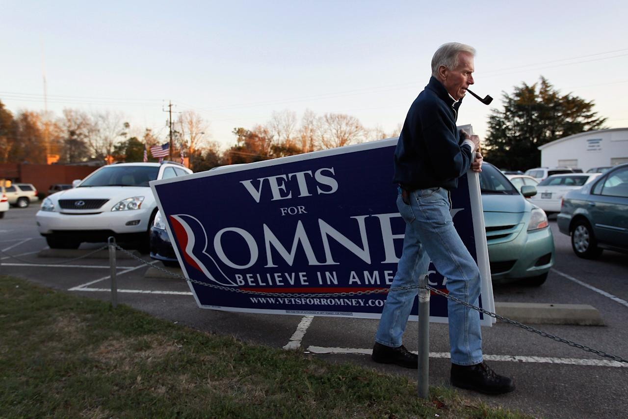 Jim Wilson pulls along a sign showing his support for Republican presidential candidate, former Massachusetts Gov. Mitt Romney  during a campaign rally at American Legion post 15 on January 14, 2012 in Sumter, South Carolina. Romney continues to campaign for votes in South Carolina ahead of their primary on January 21st.  (Photo by Joe Raedle/Getty Images)