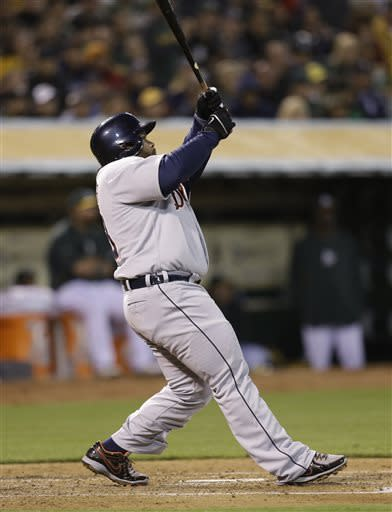 Detroit Tigers' Prince Fielder swings for a three-run home run off Oakland Athletics' Bartolo Colon in the third inning of a baseball game on Friday, April 12, 2013, in Oakland, Calif. (AP Photo/Ben Margot)