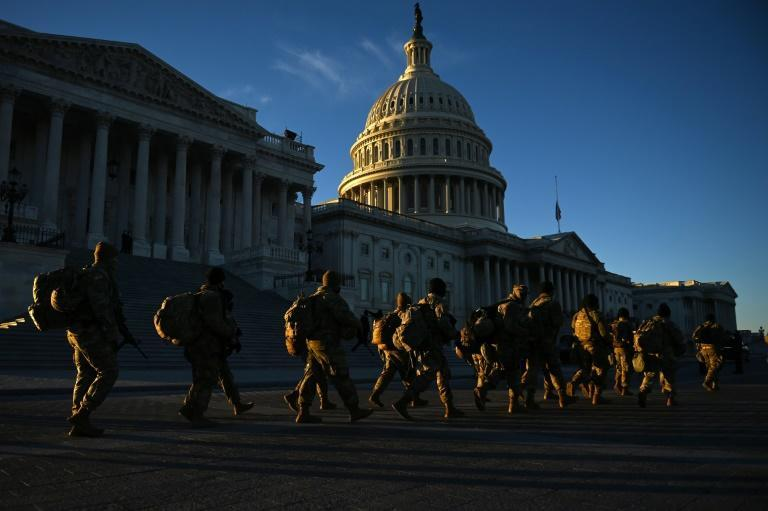 US National Guard walk past the Capitol in Washington