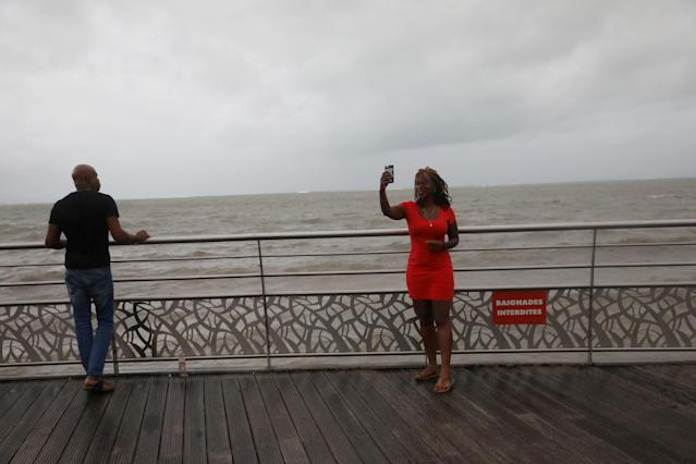 <p>A woman takes a selfie as Hurricane Maria approaches in Petit-Bourg, Guadeloupe island, France, Sept. 18, 2017. (Photo: Andres Martinez Casares/Reuters) </p>