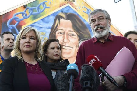 Sinn Fein President Gerry Adam sand Sinn Fein leader Michelle O'Neill speak to media outside the Sinn Fein offices on Falls Road in Belfast, Northern Ireland March 4, 2017. REUTERS/Clodagh Kilcoyne