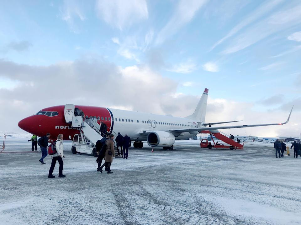 FILE PHOTO: Passengers board a Norwegian Air plane in Kirkenes, Norway October 26, 2019.  REUTERS/Gwladys Fouche/File Photo