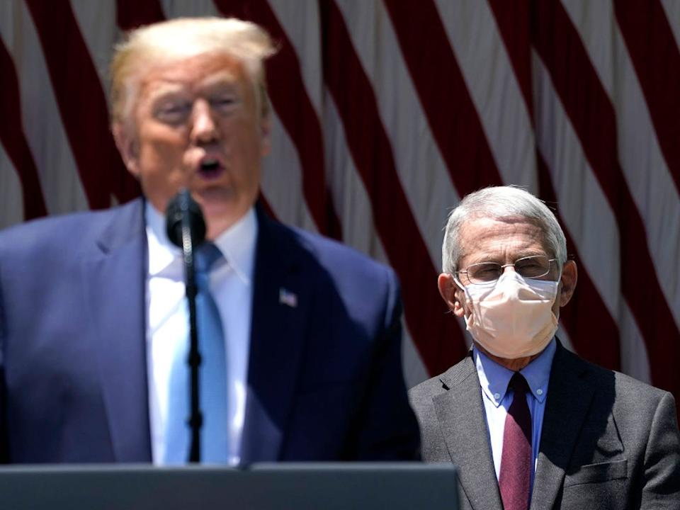 "President Donald Trump is flanked by Dr. Anthony Fauci, director of the National Institute of Allergy and Infectious Diseases while speaking about coronavirus vaccine development in the Rose Garden of the White House on May 15, 2020 in Washington, DC. <p class=""copyright"">Drew Angerer/Getty Images</p>"