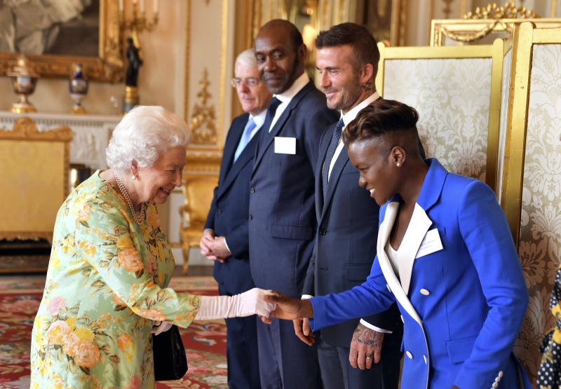 Britain's Queen Elizabeth meets with, from left, Sir John Major, Sir Lenny Henry, David Beckham and Nicola Adams before the final Queen's Young Leaders Awards Ceremony at Buckingham Palace in London, Tuesday, June 26, 2018. (John Stillwell/Pool Photo via AP)