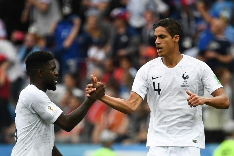 Hard to beat: Raphael Varane (right) and Samuel Umtiti have formed a strong partnership at the heart of the French defence