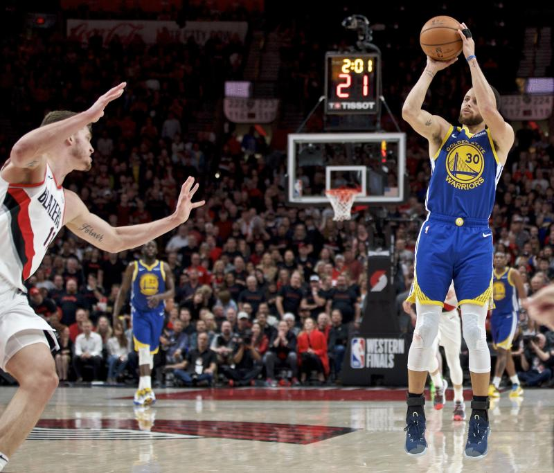 Golden State Warriors guard Stephen Curry, right, shoots a 3-point basket over Portland Trail Blazers forward Meyers Leonard during the first half of Game 3 of the NBA basketball playoffs Western Conference finals Saturday, May 18, 2019, in Portland, Ore. (AP Photo/Craig Mitchelldyer)
