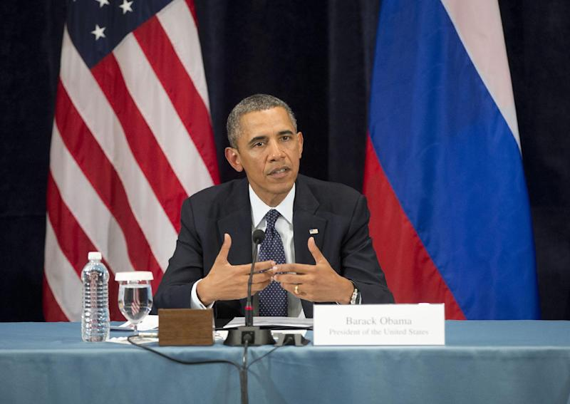 "President Barack Obama gestures while speaking during a ""Civil Society Roundtable"" with gay, lesbian, bisexual and transgender activists, Friday, Sept. 6, 2013, in St. Petersburg, Russia. (AP Photo/Pablo Martinez Monsivais)"