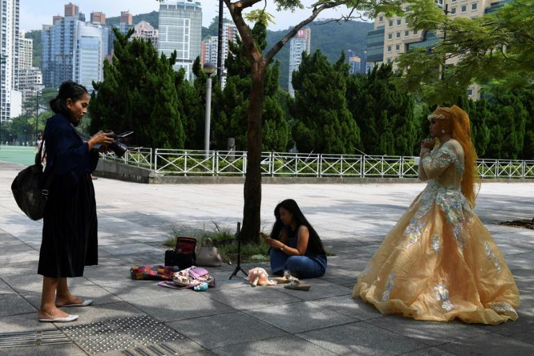 Domestic workers get one day off a week -- usually a Sunday -- and often spend it in parks with their friends (AFP Photo/Mohd RASFAN)