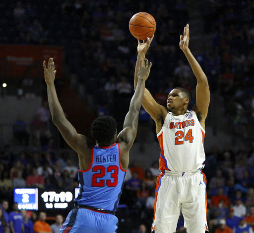lorida center Kerry Blackshear (24) shoots a 3-pointer over Mississippi forward Sammy Hunter (23) during an NCAA college basketball game Tuesday, Jan. 14, 2020, in Gainesville, Fla. (Brad McClenny/The Gainesville Sun via AP)