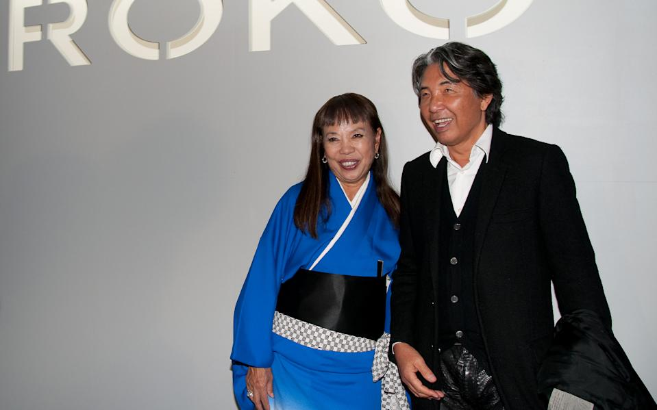 PARIS - SEPTEMBER 30: (L-R) Hiroko Koshino and Kenzo Takada pose for Hiroko Koshino's Art and Fashion Exhibition Launch during Paris Fashion Week Ready To Wear Spring / Summer 2011 at Cite de l'Architecture et du Patrimoine on September 30, 2010 in Paris, France. (Photo by Pierre-Henri Pham/Getty Images)