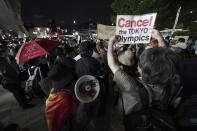 FILE - In this July 23, 2021, file photo, people protest against the Olympics near the National Stadium in Tokyo, Japan where the opening ceremony of the Tokyo Olympics took place. (AP Photo/Kantaro Komiya, File)