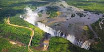 """<p>Victoria Falls straddles the border between Zambia and Zimbabwe on the Zambezi River. One of the best vantage points in which to view this mile-long waterfall is from <a href=""""https://www.tripadvisor.com/Attraction_Review-g298089-d638662-Reviews-Livingstone_Island_Tour-Livingstone_Southern_Province.html"""" rel=""""nofollow noopener"""" target=""""_blank"""" data-ylk=""""slk:Livingstone Island"""" class=""""link rapid-noclick-resp"""">Livingstone Island</a>, so named for David Livingstone, the first Westerner to come across the falls in 1855. </p><p>Vic Falls has long been considered one of the most beautiful places in the world — and one of the most adventurous, with bungee jumping, zip lining, and white-water rafting all in the vicinity of the falls. </p>"""