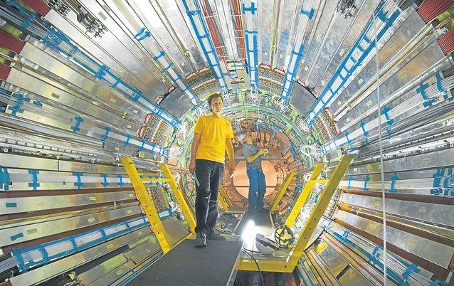PHYSICS AT WORK: Scientists are seen working on the ATLAS experiment, one of four experiments on the Large Hadron Collider. The Large Hadron Collider is a particle accelerator, 27km long, that straddles the border between France and Switzerland. Picture: CERN
