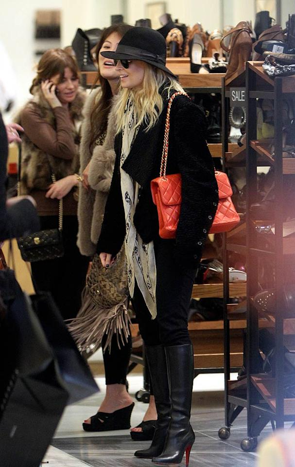 "As did newlywed Nicole Richie, who sported a funky hat, knee-high boots, and festive red Chanel bag for her trip to the luxury retailer. Blanco-Jesse/<a href=""http://www.x17online.com"" target=""new"">X17 Online</a> - December 21, 2010"