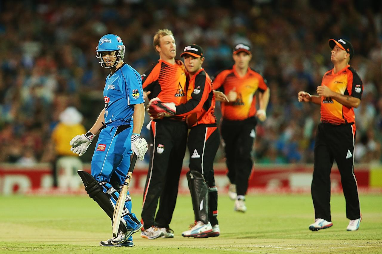 ADELAIDE, AUSTRALIA - JANUARY 10: Michael Klinger of Adelaide leaves the field after getting out as Michael Beer of Perth celebrates with team mates during the Big Bash League match between the Adelaide Strikers and the Perth Scorchers at Adelaide Oval on January 10, 2013 in Adelaide, Australia.  (Photo by Morne de Klerk/Getty Images)