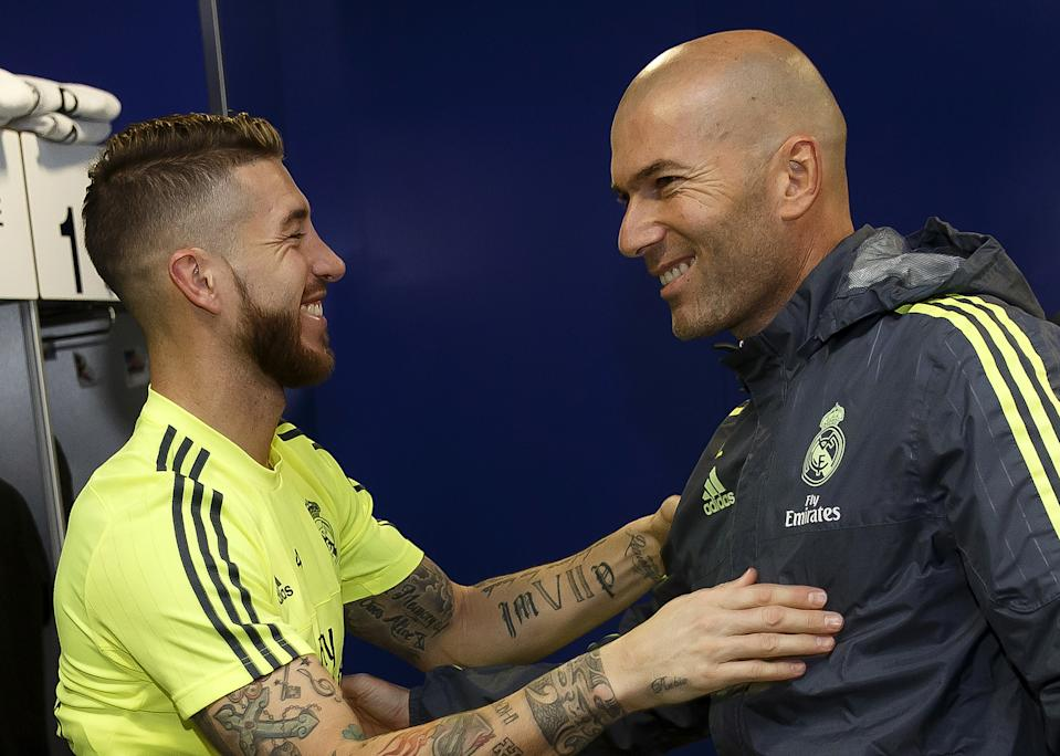 MADRID, SPAIN - JANUARY 05:  Head coach Zinedine Zidane (R) of Real Madrid greets Sergio Ramos before a training session at Estadio Alfredo Di Stefano on January 5, 2016 in Madrid, Spain.  (Photo by Angel Martinez/Real Madrid via Getty Images)