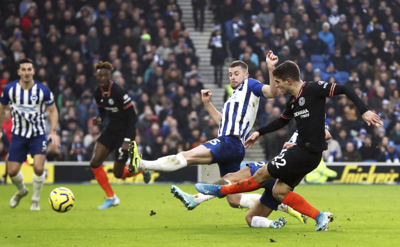 Chelsea's Christian Pulisic, right, shoots wide, during the English Premier League soccer match between Brighton and Chelsea at the AMEX Stadium, Brighton, England, Wednesday Jan. 1, 2020. (Gareth Fuller/PA via AP)