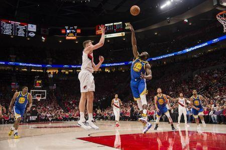 May 20, 2019; Portland, OR, USA; Portland Trail Blazers forward Meyers Leonard (11) shoots a basket against Golden State Warriors forward Draymond Green (23) during the first half in game four of the Western conference finals of the 2019 NBA Playoffs at Moda Center. Mandatory Credit: Troy Wayrynen-USA TODAY Sports