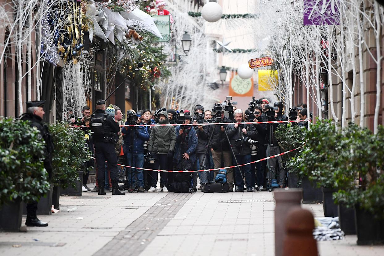 Media gather near the Christmas Market where a deadly shooting took place, in Strasbourg, France, Dec. 12, 2018. (Photo: Patrick Seeger/EPA-EFE/REX/Shutterstock)