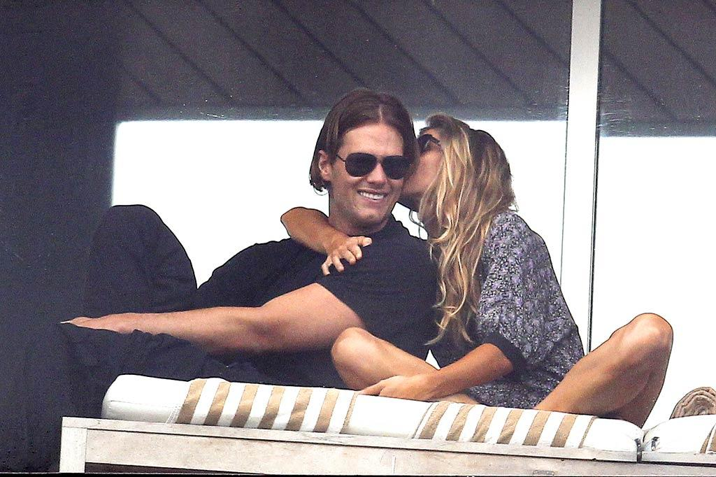 "On Monday, Gisele Bundchen was spotted riding on a float during a Carnival celebration at Sambadrome in Rio de Janeiro, Brazil, but Tuesday was for relaxing and smooching with her hunky hubby Tom Brady. Wagner Az/<a href=""http://www.pacificcoastnews.com/"" target=""new"">PacificCoastNews.com</a> - March 7, 2011"