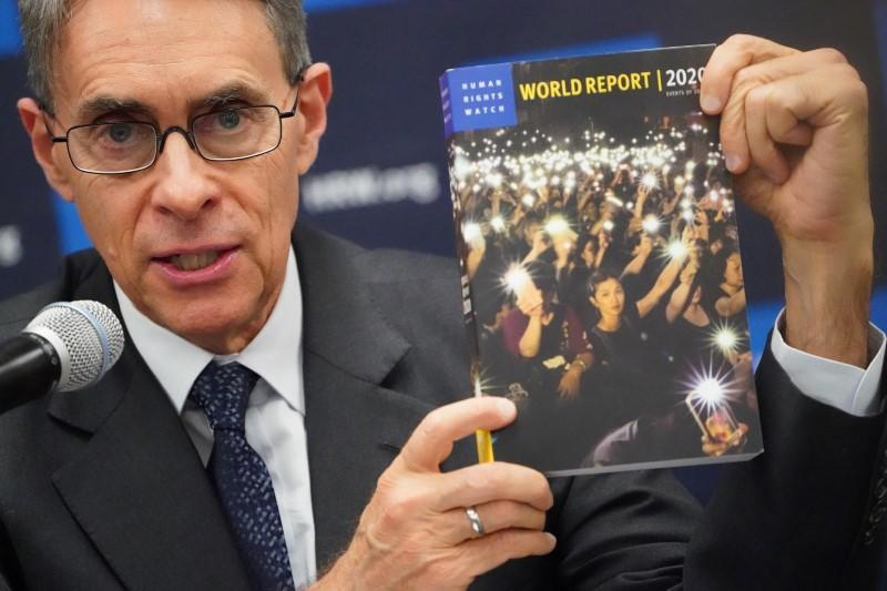 Kenneth Roth, the Executive Director of Human Rights Watch holds up their World Report 2020 at the United Nations in the Manhattan borough of New York City