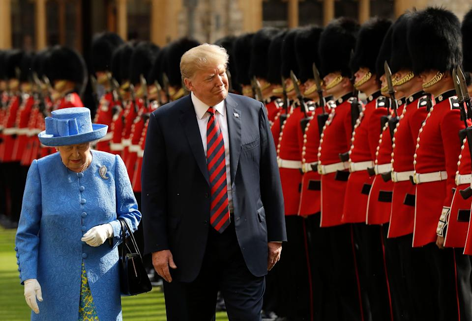 President Donald Trump and Queen Elizabeth II inspect a Guard of Honour at Windsor Castle, July 13, 2018.