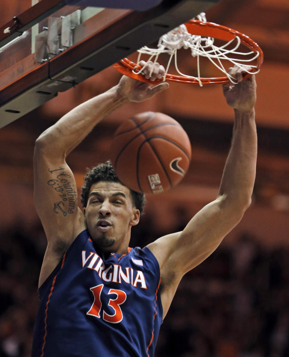 Virginia forward Anthony Gill dunks during the first half of an NCAA college basketball game against James Madison in Harrisonburg, Va., Friday, Nov. 14, 2014. (AP Photo/Steve Helber)