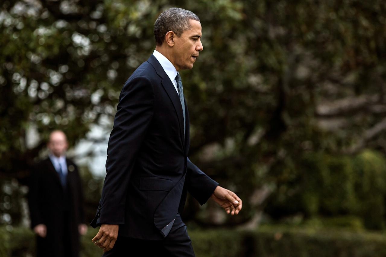 WASHINGTON, DC - DECEMBER 16:  (AFP OUT)  U.S. President Barack Obama departs the White House to travel to Connecticut December 16, 2012 in Washington, DC. President Obama will meet with the families of victims of the shooting at Sandy Hook Elementary School in Newtown.  (Photo by Brendan Hoffman-Pool/Getty Images)