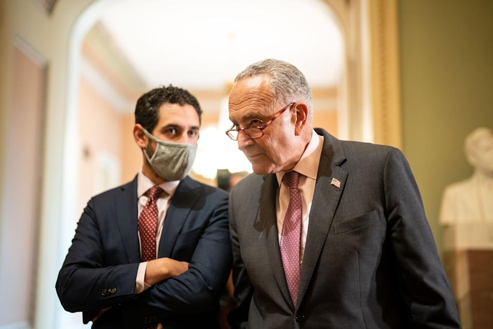 Chuck Schumer, right, with a staffer
