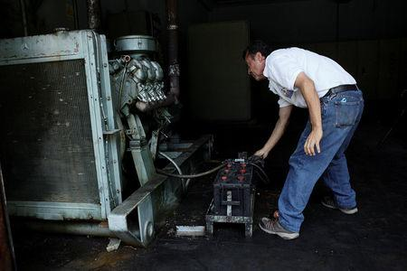 A worker tries to start the generator of the Padre Justo hospital during a blackout in Rubio, Venezuela March 14, 2018. Picture taken March 14, 2018. REUTERS/Carlos Eduardo Ramirez