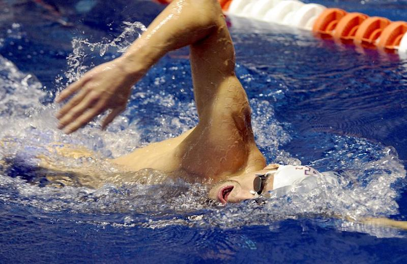 U.S. Olympic swim team member Michael Phelps practices at the University of Tennessee's Allan Jones Aquatic Center, Thursday, July, 12, 2012, in Knoxville, Tenn. (AP Photo/Knoxville News Sentinel, Michael Patrick)
