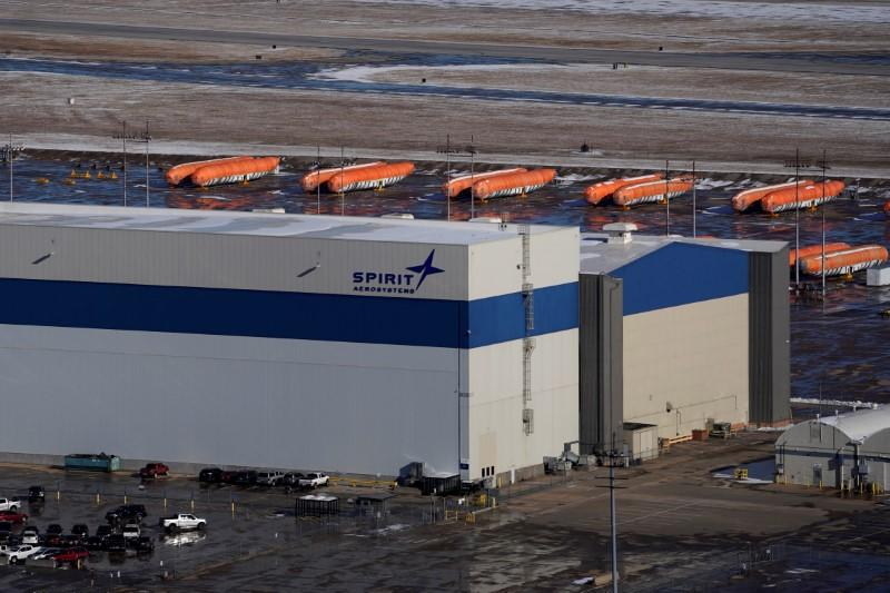 FILE PHOTO: Airplane fuselages bound for Boeing's 737 Max production facility sit in storage behind Spirit AeroSystems Holdings Inc headquarters, in Wichita