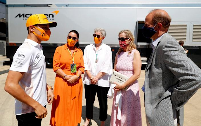 NORTHAMPTON, ENGLAND - JULY 18: Prince Edward, Earl of Wessex and Sophie, Countess of Wessex speak with Lando Norris (left) during a visit to the McLaren team garage at the British Grand Prix in Silverstone on July 18, 2021 in Northampton, England. Before the start of the race at Silverstone, Edward and Sophie met McLaren drivers Lando Norris and Daniel Ricciardo and their team which is joining forces with the DofE to encourage the public to take part in the charity's new fundraising challenge Do It 4 Youth. - Getty Images