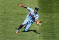 Minnesota Twins left fielder Eddie Rosario slides to make a catch of a ball hit by Kansas City Royals' Hunter Dozier and throws out the runner who ran on the play for a double play in the sixth inning of a baseball game Sunday, Aug. 16, 2020, in Minneapolis. (AP Photo/Bruce Kluckhohn)