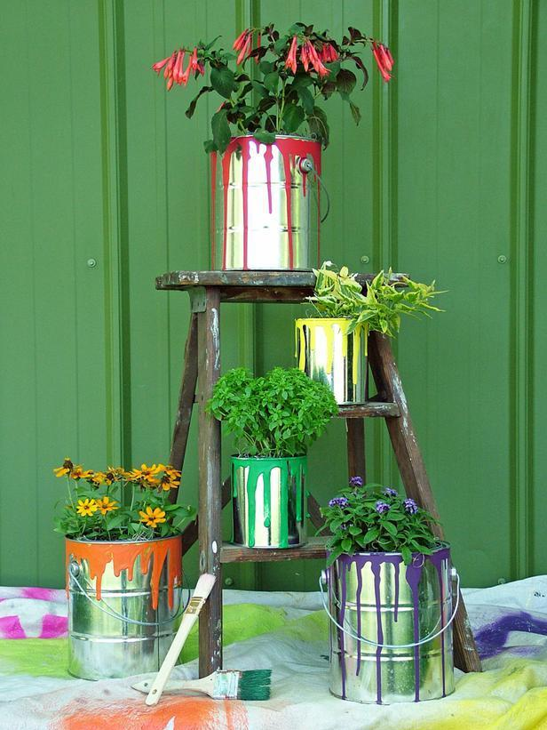 """<div class=""""caption-credit"""">Photo by: Nancy Ondra</div><div class=""""caption-title"""">Color Your World</div>Recycle your old paint cans into pretty container gardens. Or buy metal paint cans at hardware stores and home centers. To dress them up, drizzle craft paint around the top rim and add some drips down the sides. Cover with a coat of polyurethane to stop the cans from rusting, or leave them untreated and enjoy the rusty, rustic look that develops within a few months."""