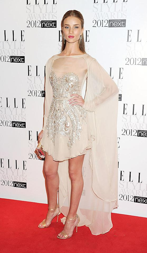 "It's a bird, it's a plane -- it's Super Rosie Huntington-Whiteley! The ""Transformers"" star accessorized her shimmery Ice Capades-inspired mini with a sheer white cape at the Elle Style Awards on Monday. (2/13/2012)"