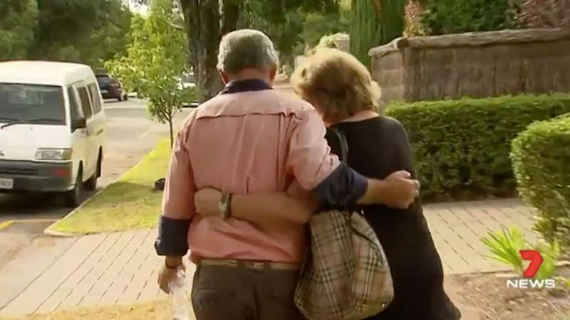 Mr Jankovic is comforted by his wife at the scene. Source: 7 News