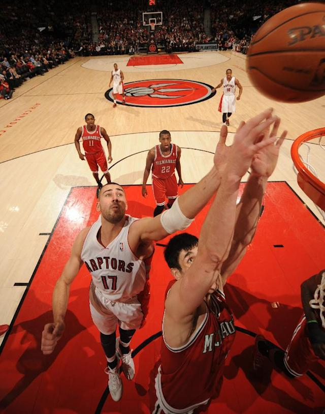 TORONTO, CANADA - January 13: Jonas Valanciunas #17 of the Toronto Raptors going up for a rebound during a game against the Milwaukee Bucks during the game on January 13, 2014 at the Air Canada Centre in Toronto, Ontario, Canada. (Photo by Ron Turenne/NBAE via Getty Images)