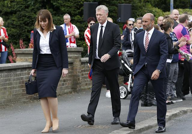 <p>David Moyes (centre) outside St Joseph's Church in Blackhall, County Durham, where the funeral of Bradley Lowery, the six-year-old football mascot whose cancer battle captured hearts around the world </p>
