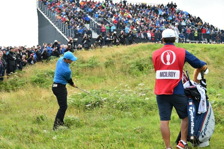 Bad to worse: Rory McIlroy started with a quadruple bogey in an eight over par first round at the British Open