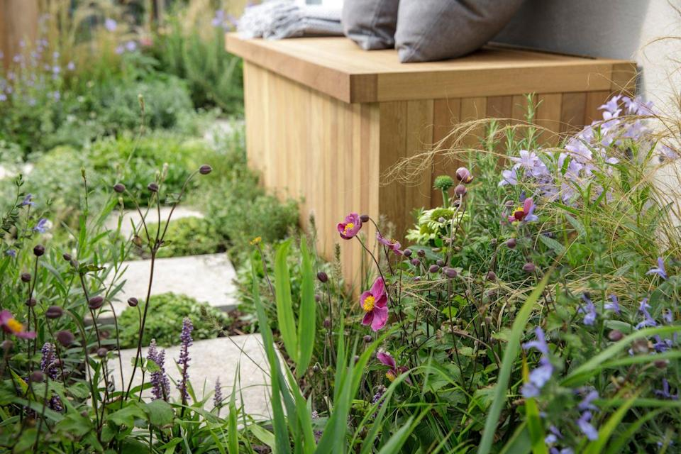 """<p>Designed as an antidote for busy city living, this balcony garden is a """"green oasis in the clouds"""". It's a lush green pocket of peace, with planters, sculptures, a wooden bench and vegetation. </p><p><strong>READ MORE</strong>: <a href=""""https://www.countryliving.com/uk/homes-interiors/gardens/a27529309/chelsea-flower-show-winners/"""" rel=""""nofollow noopener"""" target=""""_blank"""" data-ylk=""""slk:Winners of Chelsea Flower Show 2021 revealed"""" class=""""link rapid-noclick-resp"""">Winners of Chelsea Flower Show 2021 revealed</a></p>"""