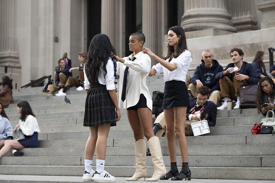 """<p>Obviously, we were curious to learn how exactly the reboot would both pay homage to the OG series and differ from it. """"I wanted to make it feel very contemporary, current, and speak to the Gen Z generation,"""" Eric told POPSUGAR. </p> <p>""""These students are a part of the generation that has ushered us into this brave new fashion world that we're in, but I also wanted to pay homage to the OG <strong><a class=""""link rapid-noclick-resp"""" href=""""https://www.popsugar.com/Gossip-Girl"""" rel=""""nofollow noopener"""" target=""""_blank"""" data-ylk=""""slk:Gossip Girl"""">Gossip Girl</a></strong> because the fans want some opulence as well. The school uniforms are the biggest connecting connective tissue between the two worlds. I wanted to leave behind the heavily embellished, Crayola-colored tights and bring [the uniforms] into this modern world with athleisure pieces. I wanted to give the nod to what's going on trend-wise as far as replacing schoolgirls' skirts with biker shorts.""""</p>"""