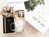 <p>The <span>Personalized Graduation Gift Box Gift</span> ($50, and up) is filled with goodies that will actually be put to use. From a notebook with a stunning pen to a scrunchie and a mug and more, this gift box is perfect for a new graduate!</p>